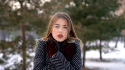 Young woman freezing in cold