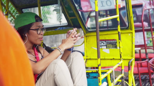young woman from philippines using cellphone - philippines stock videos & royalty-free footage