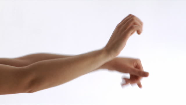 CU, Young woman gesturing in studio, close up of hands