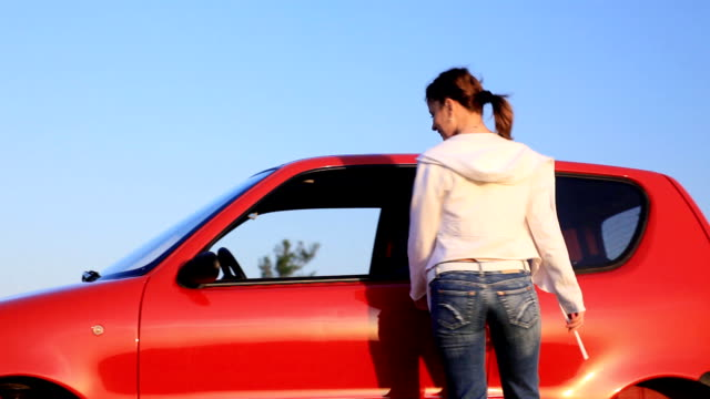young woman geting into the car  and driving. - young women stock videos & royalty-free footage