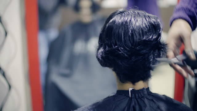 young woman getting a hair cut. - south asia stock videos & royalty-free footage