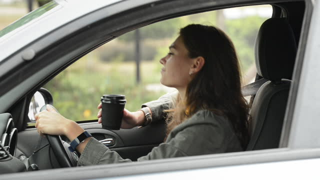 young woman getting impatient in her car during rush hour - traffic jam stock videos & royalty-free footage
