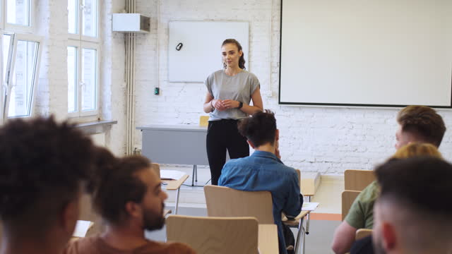 young woman giving presentation in university - three quarter length stock videos & royalty-free footage