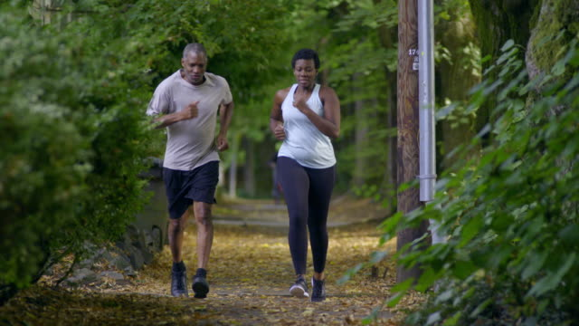 Young woman goes jogging with her father.