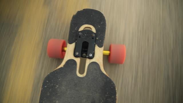 a young woman goes longboard skateboarding. - longboarding stock videos & royalty-free footage