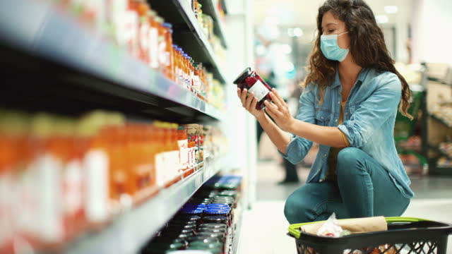 young woman going grocery shopping after business reopened during coronavirus pandemic - household equipment stock videos & royalty-free footage