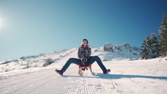 young woman going on a new sleigh ride - sledge stock videos & royalty-free footage