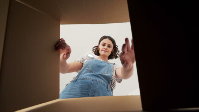 young woman grabbing a adhesive tape. - moving house stock videos & royalty-free footage