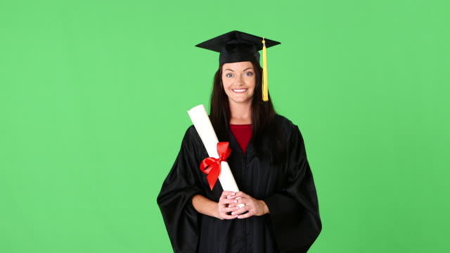 Young woman graduate in gown with diploma