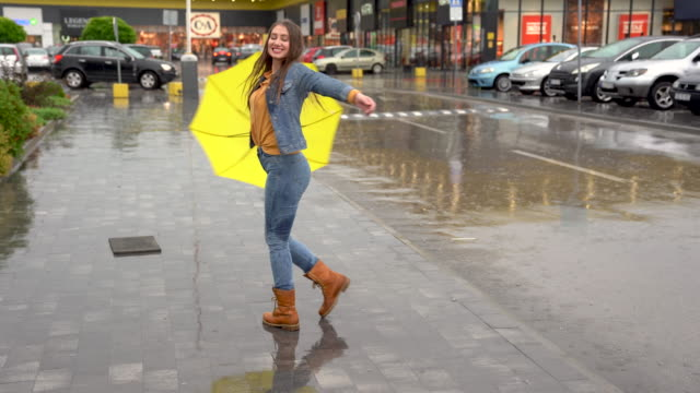 young woman happily spinning on the rain - wet wet wet stock videos & royalty-free footage