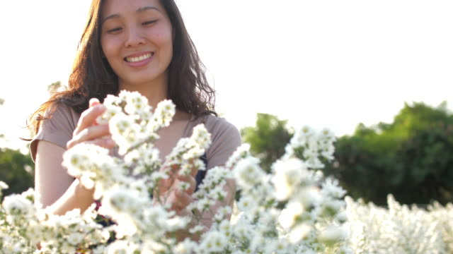 young woman happiness at flower garden - aromatherapy stock videos & royalty-free footage