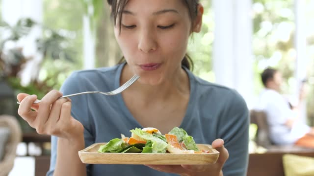 young woman happy face eating salad happy face, healthy eating - salad stock videos & royalty-free footage