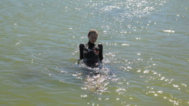 clip young woman have mud therapy outdoors summer - dead sea stock videos and b-roll footage