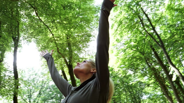 young woman having a fresh morning outdoor excercise - arms raised stock videos & royalty-free footage