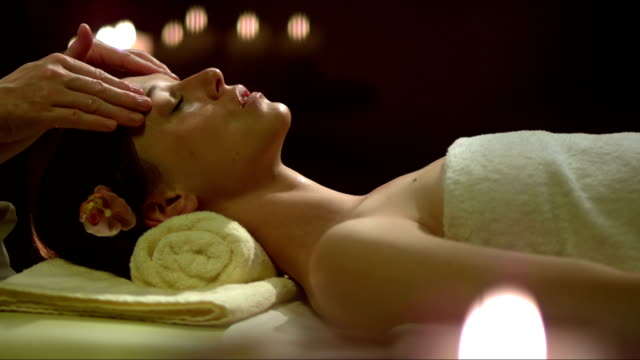 young woman having a head massage - spa stock videos & royalty-free footage
