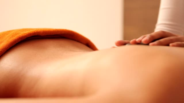young woman having a stone massage - 18 19 years stock videos and b-roll footage