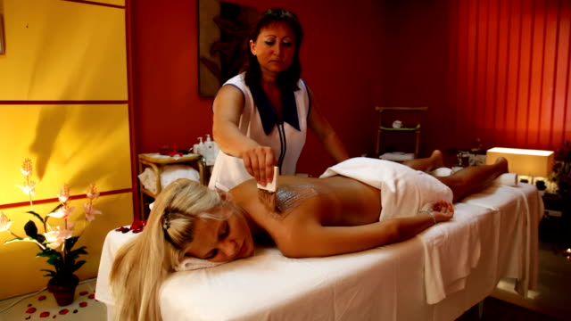 stockvideo's en b-roll-footage met young woman having chocolate body mask. - spa treatment