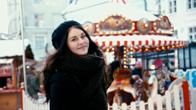 Young Woman having Fun at Christmas Market