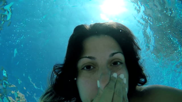 Young woman having fun underwater