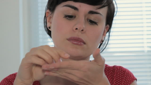 cu young woman having headache and taking medicine / london, united kingdom - junge frauen stock-videos und b-roll-filmmaterial