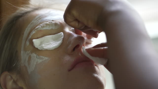 a young woman having her eyebrows bleached - eyebrow stock videos & royalty-free footage