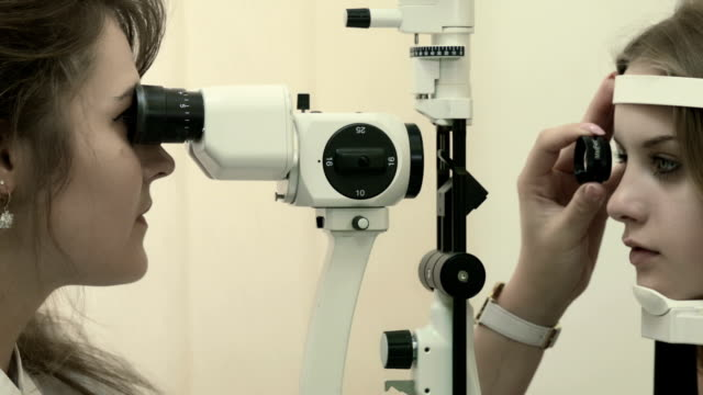 Young woman having her eyesight examined
