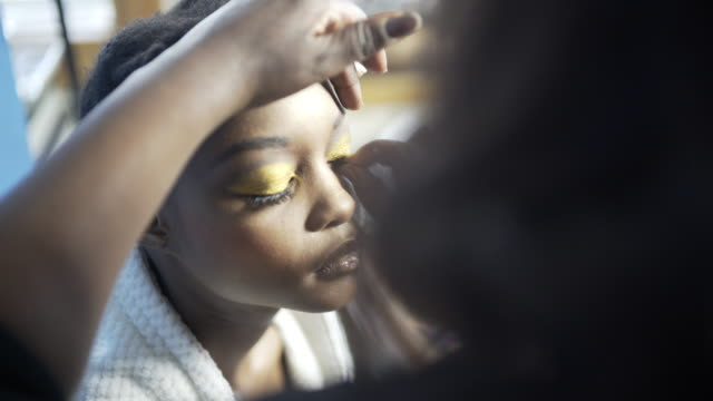 a young woman having her hair and make-up created. - natural black hair stock videos & royalty-free footage