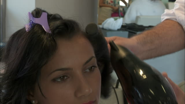 cu ha young woman having her hair done at hair salon, rome, italy - hair accessory stock videos & royalty-free footage