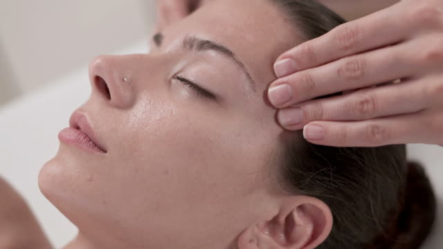 hd: young woman having relaxing facial massage - facial massage stock videos and b-roll footage