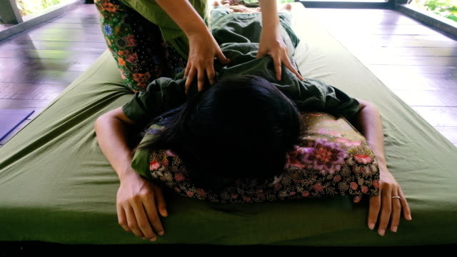 young woman having relaxing with thai massage at garden - lymphatic system stock videos & royalty-free footage