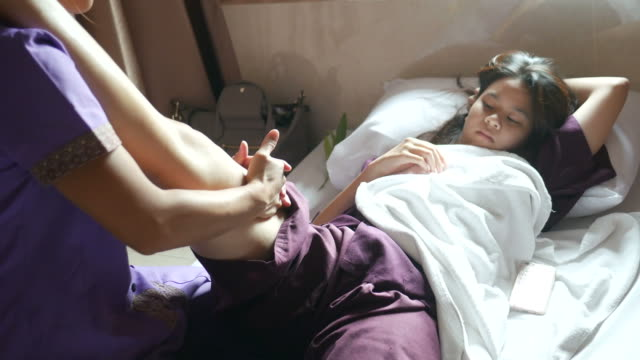 young woman having relaxing  with thai massage - reflexology stock videos and b-roll footage