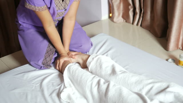 young woman having relaxing  with thai massage - anti aging stock videos and b-roll footage