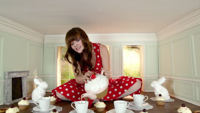 young woman having tea party in a small room - tea party stock videos and b-roll footage