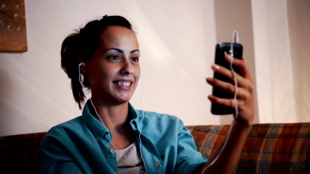 young woman having video chat - video conference stock videos & royalty-free footage