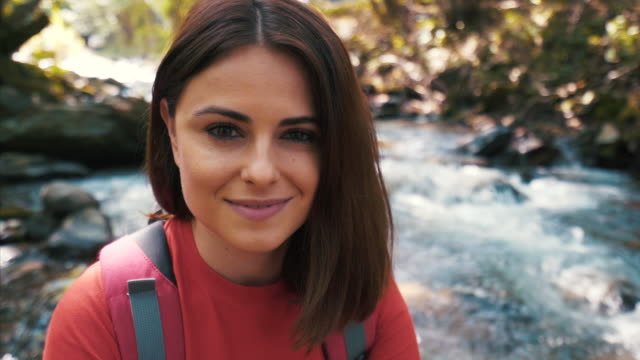 young woman hiker portrait. - one young woman only stock videos & royalty-free footage