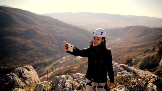 young woman hiker taking photo with smart phone - climbing stock videos & royalty-free footage