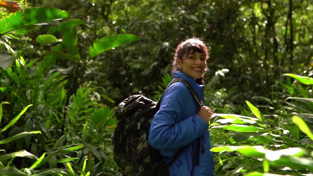 young woman hiking and looking at camera - camping stock videos & royalty-free footage