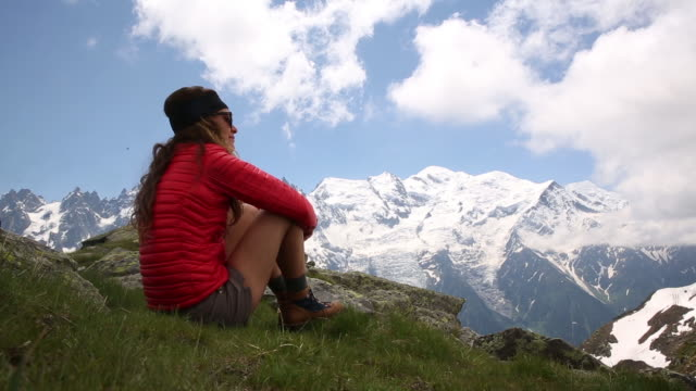 a young woman hiking in chamonix france - only mid adult women stock videos and b-roll footage