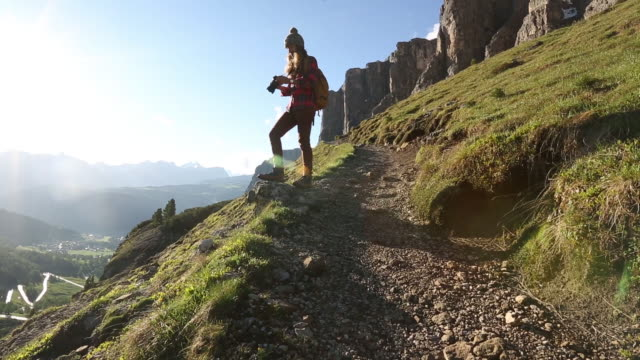 a young woman hiking in the dolomite mountains of italy. - camera photographic equipment stock videos & royalty-free footage