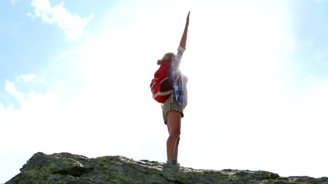young woman hiking on mountain peak-success and freedom - human limb stock videos & royalty-free footage