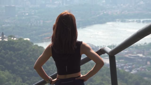 young woman hiking reaches the mountain top, success freedom concept - reaching stock videos & royalty-free footage