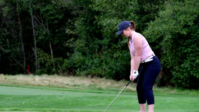 young woman hits a great golf shot - professional sportsperson stock videos & royalty-free footage