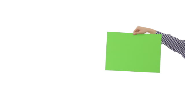 young woman holding a green blank signboard. - poster stock videos & royalty-free footage