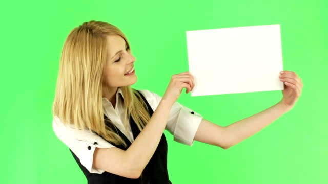 Young woman  holding a white blank board