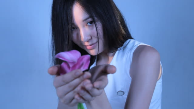 CU Young woman holding calla lily flower / New York, New York, USA