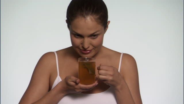 slo mo, cu, young woman holding herbal tea in studio, portrait - see other clips from this shoot 125 stock videos and b-roll footage