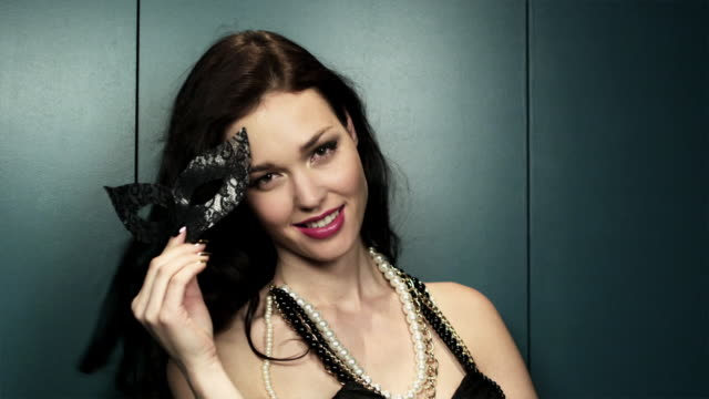 young woman holding masquerade mask - pearl jewellery stock videos & royalty-free footage