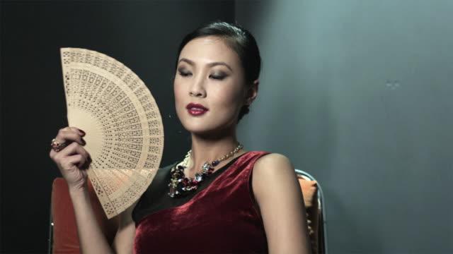 young woman holding oriental fan - hand fan stock videos & royalty-free footage