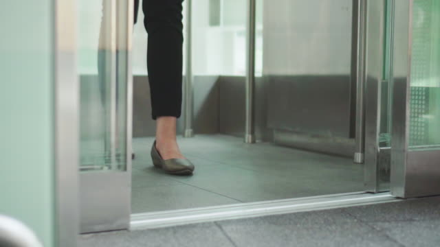young woman holding shopping bags and using elevator,tilt up - lift stock videos & royalty-free footage