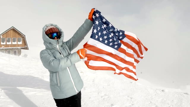 young woman holding usa flag at winter - flag blowing in the wind stock videos & royalty-free footage